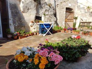 Puglia Italy tour landscape Matera sassi clothline flowers